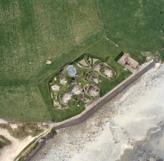Oblique aerial view centred on the prehistoric settlement at Skara Brae