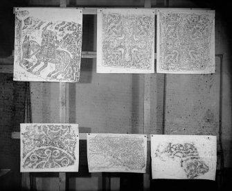 Photographic copy of six rubbings showing details of the reverse of Kirriemuir no.3 Pictish cross slab, face and reverse of Kirriemuir no.5 cross slab and Inverurie no.2 Pictish symbol stone. The middle and bottom right rubbings have not been identified.