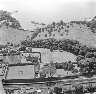 Oblique aerial view of Aberdour village, showing Aberdour Castle and dovecot, St Fillan's Church and the harbour
