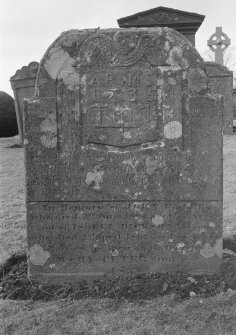View of gravestone in the churchyard of Rescobie Parish Church with initials 'A P' and 'M S' and dated 1735, and to John Peters 1808 and Isobel Dickson 1841.