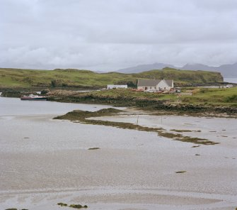 Eigg, Galmisdale Bay. View of fishtrap with pier in the background.