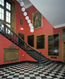 Entrance Lobby. View of staircase from north east, showing commorative plaques and portrait