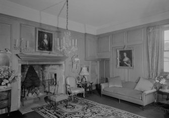 Interior view of Lickleyhead Castle showing the drawing room with fireplace.