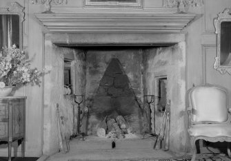 Interior view of Lickleyhead Castle showing detail of fireplace in drawing room.