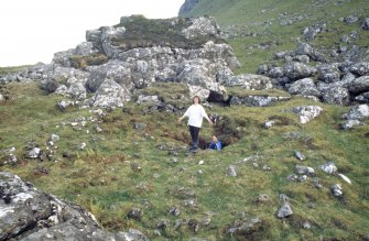 Eigg, Struidh, Ritual Enclosure. Angela Gannon and Matthew Ritchie at the entance of chamber, Struidh, Eigg.