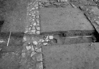 Jedburgh Abbey excavation archive Frame 6: Area 3: Trench R fully excavated. From S.