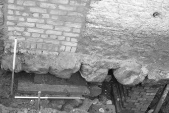 Jedburgh Abbey excavation archive 1985 Frame 14: Ashlar masonry belonging to the abbey's reredorter lying below the W wall of No.4 Abbey Bridge End. From W.