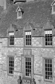 Detail of W elevation of courtyard, Cullen House showing carved pediments.