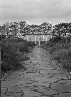 Distant view of sundial and greenhouse in walled garden, Cullen House.