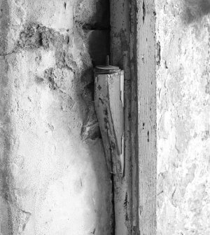 Thatched house, detail of wooden door hinge