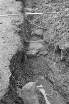 Newark Castle Frame 22 - Trench L: remnant of wall below pipe - from north