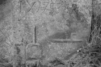 Detail of gravestone for Janet Russell dated 1753, in the churchyard of Crombie Old Parish Church.