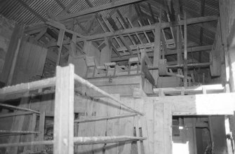 Interior and range N of 1st floor and machinery.
