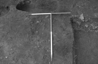Excavation photograph : trench 5, burnt stone and clay, from N.