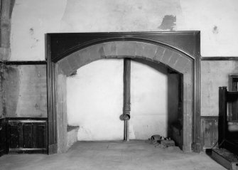 Interior view of Towie Barclay Castle showing fireplace in Great Hall.