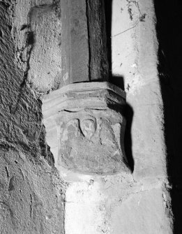 Interior view of Towie Barclay Castle showing corbel with shield with emblems of evangelist in gallery of Great Hall.