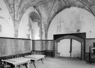 Interior view of Towie Barclay Castle showing Great Hall with fireplace.
