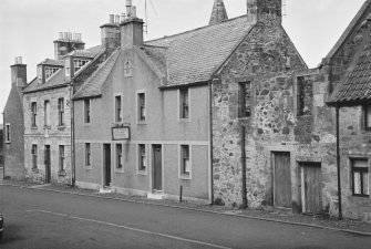 View of buildings in Cross Wynd, Falkland, including Seton House and Westfield Fish Restaurant.