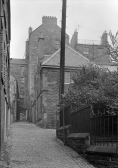 General view of South Gray's Close, Edinburgh, with 40 High Street on right and 42 High Street on left.