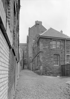 General view of South Gray's Close, Edinburgh, with 40 High Street on right, and 42 High Street on left.