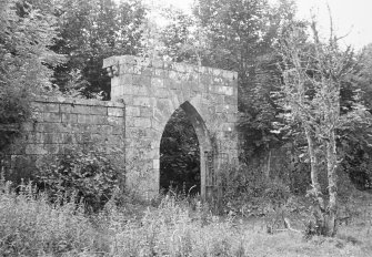General view of garden walls and gateway.