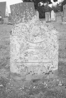 Forteviot Parish Churchyard. General view of tombstone with winged soul, shuttle, skull, hourglass and crossed bones.