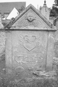 Forteviot Parish Churchyard. General view of tombstone with winged soul, plough, 'Memento Mori' ribbon, skull and crossed bones.