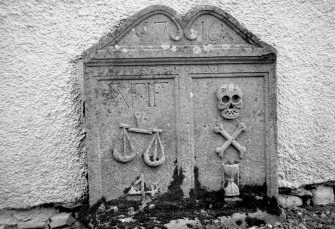 Glendevon Parish Church, Churchyard. General view of tombstone with scales and merchant's '4'sign, skull, crossed bones and hourglass. Insc:'1716. Memento Mori. A.F. I.F'.