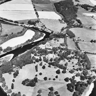 Oblique aerial view from SE, centred on the Abbey, dovecot, country house and Dryburgh House hotel.