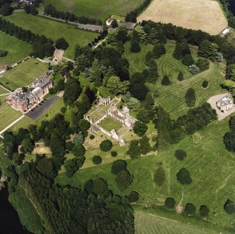 Dryburgh Abbey, oblique aerial view, taken from the SW, centred on the abbey, with Dryburgh House Hotel on the left-hand side of the photograph.