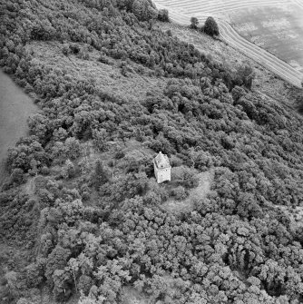 Oblique aerial view centred on the remains of the tower-house, taken from the W.