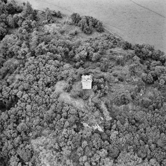 Oblique aerial view centred on the remains of the tower-house, taken from the SE.