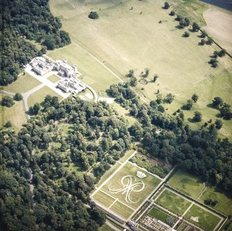 Oblique aerial view centred on the formal garden and country house, taken from the W.
