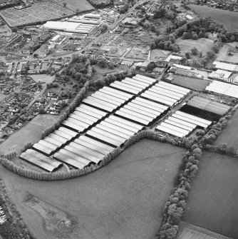 Oblique aerial view centred on the bonded stores of the Carsebridge Distillery, Alloa, taken from the SE