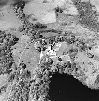 Oblique aerial view centred on the remains of the castle and tower, taken from the ESE.