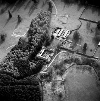Oblique aerial view of Jardine Hall stables, site of Jardine Hall and walled garden from NE.  Also a  possible field rig, c. 100 876.