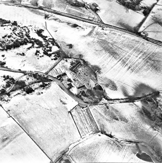 Oblique aerial view centred on the churches, burial-ground and buildings, taken from the NE.