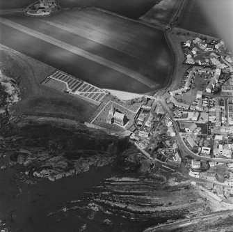 Oblique aerial view of St Monance centred on the village, church and burial ground, taken from the ESE.