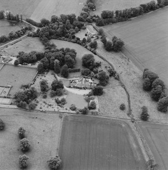 Oblique aerial photograph of Lathrisk House centred on a country house. Lathrisk Laundry house is situated to W, in the top centre of the photograph. Taken from the E.