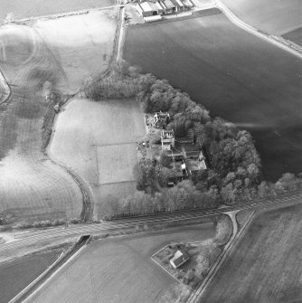 Oblique aerial view centred on the castle and tower-house, taken from the ESE.