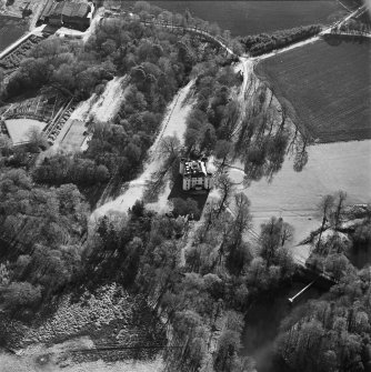Oblique aerial view centred on the castle and tower-house, taken from the NE.
