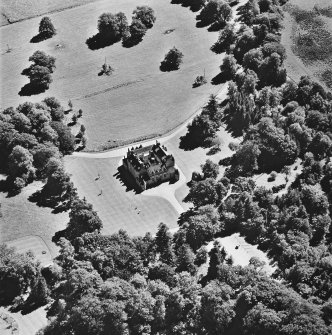 Oblique aerial view of Leith Hall centred on the country house, taken from the NW.