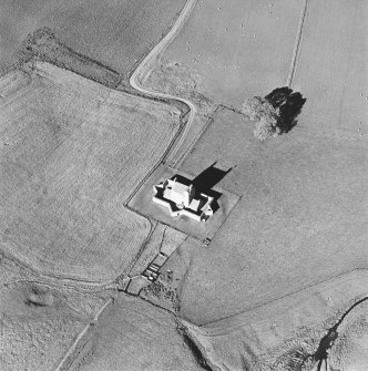 Oblique aerial view of Corgarff castle centred on the tower-house with the remains of a pond, quarry, farmstead, building and the cropmarks of a building adjacent, taken from the S.