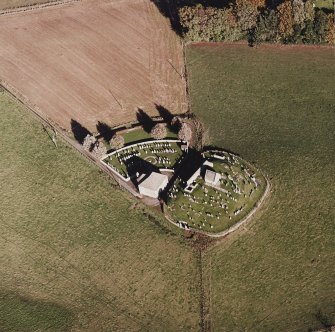 Oblique aerial view of Kildrummy, St Bride's Chapel and Well centred on the church with a possible motte and churchyard adjacent, taken from the SW.