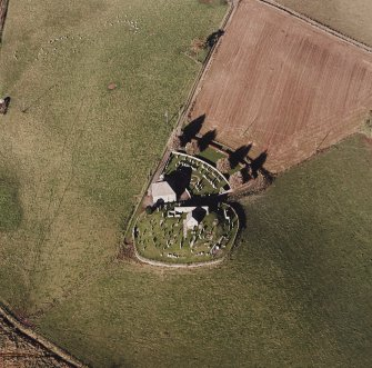 Oblique aerial view of Kildrummy, St Bride's Chapel and Well centred on the church with a possible motte and churchyard adjacent, taken from the SE.