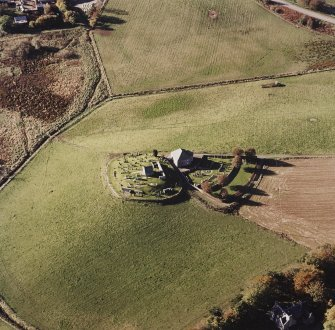 Oblique aerial view of Kildrummy, St Bride's Chapel and Well centred on the church with a possible motte and churchyard adjacent, taken from the E.