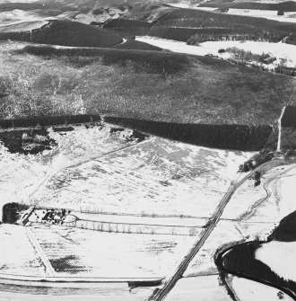 Oblique aerial view under snow, from SW.