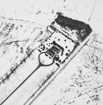 Oblique aerial view under snow, from E.