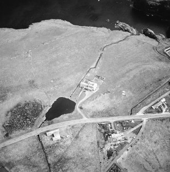 Oblique aerial view centred on the watermill with the farmsteads adjacent, taken from the NW.