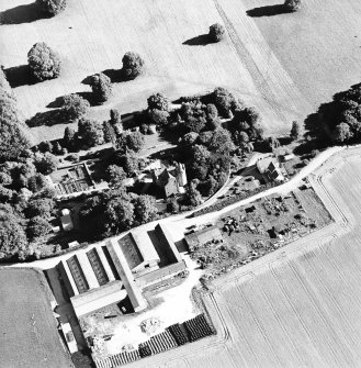 Oblique aerial view centred on the castle, steading and farmhouse, taken from the NNW.